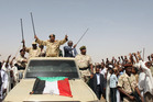 Sudanese President Omar al-Bashir (centre) has lashed out in terms reminiscent of the Hutu regime in Rwanda. Photo / AP