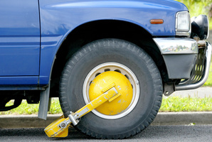 Wheel clamping is an increasingly common method of enforcement. Photo / Kenny Rodger