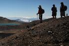Tourists look towards Blue Lake during the Tongariro crossing. Photo / Greg Bowker
