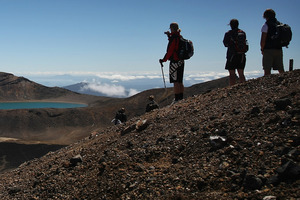 Tourists look towards Blue Lake during the Tongariro crossing. Photo / Greg Bowker