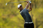 Tiger Woods watches his approach shot on the fourth hole during the pro-am of the Wells Fargo Championship golf tournament. Photo / AP