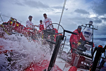 Another wave of water washes down the deck oonboard CAMPER with Emirates Team New Zealand during leg 6 of the Volvo Ocean Race 2011-12. Photo / Hamish Hooper.