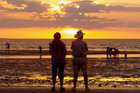 Sunset at Mindil Beach in Darwin. Every Thursday and Sunday night from April until October the beach plays host to sunset markets featuring more than 200 food, art and craft stalls. Photo / Thinkstock