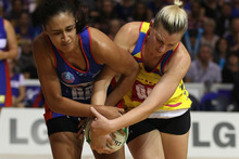 Maria Tutaia of the Mystics (L) and Katrina Grant of the Pulse tussle for the ball. Photo / Getty Images. 