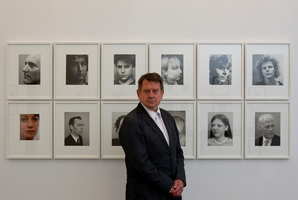 Photographer Peter Peryer with a collection of his portraits from the past 30 years. The exhibition is on display at Gus Fisher Gallery. Photo / Sarah Ivey