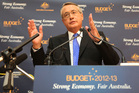 Treasurer Wayne Swan will begin today the job of selling his budget to a sceptical Australia. Photo / Getty Images