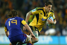 Hurricanes Jeremy Thrush is all determination against the Highlanders last night. Photo / Getty Images