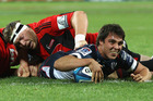 Rebels Nick Phipps scores a try. Photo / Getty Images