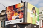 The Symonds St site makes money from billboards, and the K Rd building has well-established tenants.