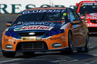 Will Davison of the Trading Post FPR team leads Jamie Whincup of Team Vodafone onto the main straight during race two of the V8 Supercars at Barbagallo Raceway. Photo / Getty Images.