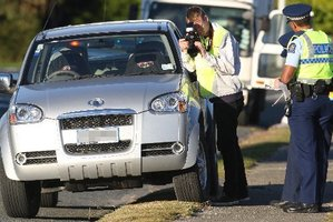 Police investigate at the scene of the accident. Photo / The Daily Post