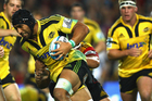 The Hurricanes' clash with the Highlanders this weekend will mark the first time most of Mark Hammett's men have played at an indoor stadium. Photo / Getty Images.