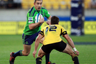 Tamati Ellison of the Highlanders runs the ball at Tim Bateman of the Hurricanes during the round four Super Rugby match between the Hurricanes and the Highlanders. Photo / Getty Images.