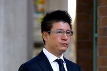 Millionaire businessman Yong Ming Yan (aka Yang Liu, aka William Yan) arrives at the Auckland High Court. Photo / Brett Phibbs