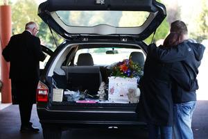 Shannon Pratt and Daniel Collier say goodbye to their son Kobi. Photo / Doug Sherring