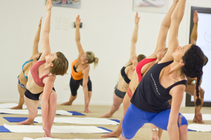Practitioners of Bikram Yoga get down to it at the East West Bikram Yoga Studio. Photo / Supplied