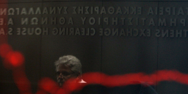 A man is reflected in the chart with stock prices at the Greek Stock Exchange in Athens. Greek parties in favour of austerity measures got just 33pc of the vote. Photo / AP
