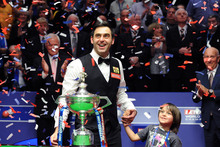 England's Ronnie O'Sullivan celebrates his victory with his son Ronnie. Photo / AP