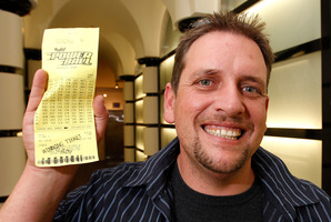 Trevor with his winning $26,000,000 Lotto ticket. Photo / Mark Mitchell