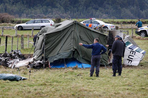 Police at the scene of the fatal aeroplane accident at the Fox Glacier airfield in South Westland. Photo / NZ Herald