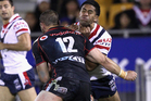Lama Tasi of the Roosters is tackled by Simon Mannering of the Warriors during the round 10 NRL match between the New Zealand Warriors and the Sydney Roosters. Photo / Getty Images.