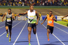 World Record holder Usain Bolt, center left, of Jamaica, crosses the finish line first to win the 100m dash. Photo / AP