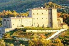 Castello di Potentino looms in the hills of Tuscany. Photo / John Sherson