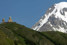 The 14th century Tsminda Sameba church is overlooked by 5047-metre Mt Kazbek. Photo / Thinkstock