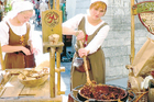 Women stir cauldrons of cinnamon and nuts for sale at Tallinn's gothic town hall. Photo / Jim Eagles