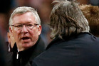 Manchester United's manager Sir Alex Ferguson, left, shouts towards Manchester City's manager Roberto Mancini, second left, as he gestures during the English Premier League soccer match. Photo / AP.