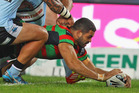Greg Inglis crossed over three times against the Sharks. Photo / Getty Images