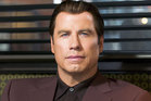 John Travolta says claims he hit on a massage therapist are a lie. Photo / Supplied
