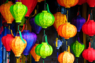 Silk lanterns offer a burst of colour in Hoi An's bustling streets. Photo / Thinkstock