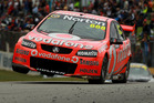 Craig Lowndes tries it on two wheels during last weekend's V8 Supercars round in Perth. Photo / Getty Images