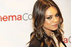Mila Kunis came to the aid of a man working on her house when he started having a seizure. Photo / AP
