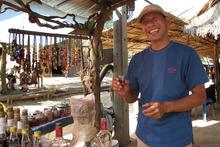 A man sells lao bong ya at Ban Xang Hai village. Photo / AAP