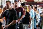 Queuing at airports is the most frustrating part of the travel experience for many people. Photo / Bloomberg News