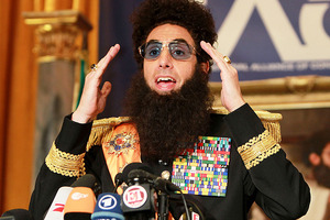 Sacha Baron Cohen has apologised for covering Ryan Seacrest in the 'ashes' of Kim Jong-Il. Photo / AP