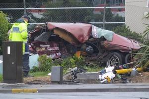 The mangled wreck of Shaun FitzPatrick's car after the crash. Photo / Jason Dorday