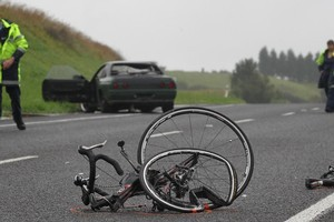 The remains of a bike left on SH36 near the Lakes subdivision in Tauranga after a cyclist was hit by a car and killed yesterday. Photo / Joel Ford