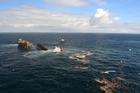 The Rena slowly sinks beneath the waves off Tauranga today. Photo / LOC