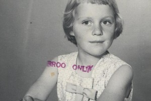 This girl's photo album discovered was found in a basement. Andy Gilbraith is trying to learn who she is. Photo / Supplied