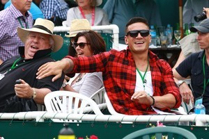 Sonny Bill and co enjoyed themselves without upsetting players - unlike the Carters crew, who put Philipp Kohlschreiber off his shot. Photo / Norrie Montgomery