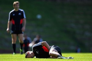 Dan Carter shows the pain of a groin injury suffered during the All Blacks' Rugby World Cup campaign. Photo / Getty Images
