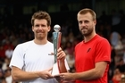 Oliver Marach and Alexander Peya (left) with the trophy. Photo / Getty Images