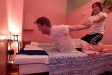 NZ Herald journalist Isaac Davison has a traditional Thai massage from Angie Lakasul.