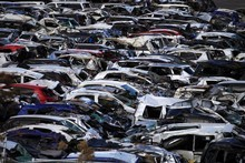 The tsunami destroyed new cars and affected production at car plants. Photo / AP
