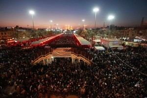 Shiite faithful pilgrims gather in front of the Imam Hussein Shrine, seen background, in Karbala, south of Baghdad, Iraq. Photo / AP