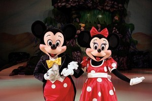 Naguib Sawiris posted a picture of Micket and Minnie Mouse dressed as conservatice Muslims. Photo / Supplied