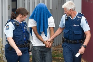 The youth charged with the Turangi tourist attack being led into the Taupo Courthouse last month. Photo / Stephen Parker